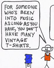 """At the office watercooler, a hipster wearing big glasses and an ironic basketball jersey says, """"For someone who's been into music for so long, you don't have very many vintage T-shirts."""""""